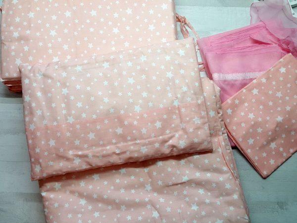 Набор в кроватку (7 предметов) розовый со звездами